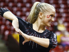 Utah's Kyndal Robarts performs on the floor during a meet against PAC-12 foe Arizona State at Wells-Fargo Arena in Tempe.  Photo by Rob Schumacher
