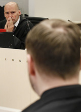 THIS IS AN ALTERNATE CROP OF LON110  Defendant Anders Behring Breivik, back to camera, looks across to his defence counsel,  Geir Lippestad, in court at the start of the 5th day of his mass killing trial in Oslo, Norway, Friday April 20, 2012. Confessed mass murderer Breivik testified Thursday in a chilling account of his preparations for the massacre of 77 people. (AP Photo/Heiko Junge, NTB Scanpix Pool)