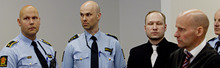 Defendant Anders Behring Breivik, 3rd right, and his defence lawyer Geir Lippestad, right,  pictured after the court broke for lunch on the 5th day of his mass killing trial in Oslo, Norway, Friday April 20, 2012. Confessed mass murderer Breivik testified Friday on his preparations for the massacre of 77 people. (AP Photo / Stian Lysberg Solum, POOL)