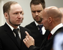 Defendant Anders Behring Breivik  with his lawyers Geir Lippestad right  and Odd Ivar Groen during the third day of proceedings in courtroom 250 in the courthouse in Oslo Wednesday April 18, 2012. Confessed mass killer Breivik on Wednesday called Norway's prison terms
