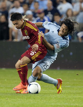 Real Salt Lake's Sebastion Velasquez fights for the ball with Sporting Kansas City's Roger Espinoza during an MLS soccer match, Saturday, April 14, 2012, in Kansas City, Kan. Sporting Kansas City won 1-0. (AP Photo/The Kansas City Star, Andy Lundberg)