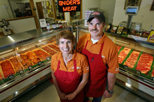 Steve Griffin/The Salt Lake Tribune   Will Wilson, a fifth-generation meat cutter, with his wife Amy Miller in their Snider's Brothers Meats store in Holladay, Utah Thursday April 12, 2012. The WIlson's have run the store since it opened in 1992.