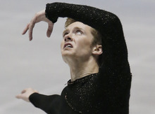 Jeremy Abbott of the United States performs during the men's free program of the ISU World Team Trophy figure skating in Tokyo, Japan, Friday, April 20, 2012. (AP Photo/Itsuo Inouye)