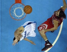 New Orleans Hornets power forward Gustavo Ayon (15) battles under the rim against Houston Rockets power forward Luis Scola, right, in the second half of an NBA basketball game in New Orleans, Thursday, April 19, 2012. The Hornets won 105-99. (AP Photo/Gerald Herbert)