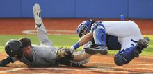 Valparaiso's Chris Manning is tagged out at home by Indiana State catcher Jeremy Lucas during a college baseball game Tuesday, April 17, 2012, in Terre Haute, Ind. (AP Photo/Tribune-Star, Jim Avelis)