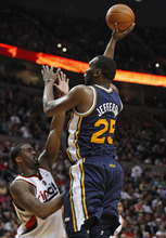 Utah Jazz's Al Jefferson (25) shoots over Portland Trail Blazers' Wesley Matthews, left, in the first quarter of an NBA basketball game Wednesday, April 18, 2012, in Portland, Ore.  (AP Photo/Rick Bowmer)