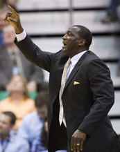 Utah Jazz head coach Tyrone Corbin calls out a play to his team during the first half of an NBA basketball game against the Dallas Mavericks, Monday, April 16, 2012, in Salt Lake City. The Jazz beat the Mavericks in triple overtime, 123-121. (AP Photo/Colin E Braley)