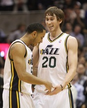 Rick Egan    The Salt Lake Tribune   Devin Harris (5) and Gordon Hayward (20) celebrate as the Jazz go up 100-96 over the Mavericks in a game at the EnergySolutions Arena, Monday, April 16, 2012.