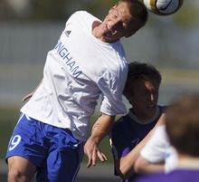 Trent Nelson  |  The Salt Lake Tribune Bingham's Tyler Devenberg heads the ball as Bingham defeats Lehi 2-1 in boys high school soccer Friday, April 20, 2012 in South Jordan, Utah.