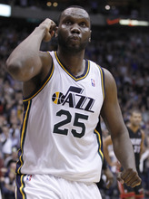 Utah Jazz's Al Jefferson celebrates the game winning shot against the Miami Heat during the second half of an NBA basketball game in Salt Lake City, Friday, March 2, 2012. The Jazz Beat the Heat 99-98. (AP photo/George Frey)
