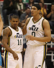Rick Egan  | The Salt Lake Tribune   Utah Jazz point guard Earl Watson (11) a is patted on the back by Enes Kanter (0) after he drew a charging foul, in NBA action, Utah Jazz vs. The New Orleans Hornet's, at EnergySolutions Arena, Monday, January 2, 2012.