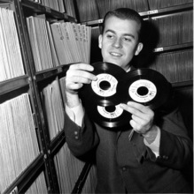 FILE - In this Feb. 3, 1959 file photo, Dick Clark selects a record in his station library in Philadelphia. Clark, the television host who helped bring rock `n' roll into the mainstream on
