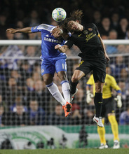 Chelsea's Didier Drogba, left, jumps to head the ball with Barcelona's Carles Puyol during their Champions League semifinal first leg soccer match at Chelsea's Stamford Bridge stadium in London,Wednesday, April 18, 2012. (AP Photo/Kirsty Wigglesworth)