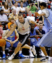 Houston Rockets' Blake Ahearn (18) drives past Denver Nuggets' Romel Beck during an NBA summer league basketball game in Las Vegas on Wednesday, July 14, 2010. (AP Photo/Louie Traub)
