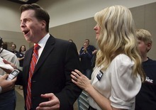 Leah Hogsten  |  The Salt Lake Tribune Former state Sen. Dan Liljenquist wipes sweat from his brow while talking to reporters with his wife Brooke, after learning that he and six-term Sen. Orrin Hatch will face a primary election. Hatch came up just short of the support needed to claim his party's nomination outright. The two square off in a June 26 primary.