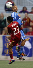 Steve Griffin/The Salt Lake Tribune   RSL's Paulo Junior crashes into Montreal's Matteo Ferrari as he goes for the ball during the RSL versus Montreal soccer game at Rio Tinto Stadium in Sandy Wednesday April 4, 2012.