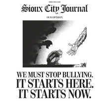 This image shows the top half of the front page of The Sioux City Journal's Sunday, April 22, 2012, edition, featuring a full-page piece to an anti-bullying editorial after a gay teen committed suicide.  The Sioux City Journal's front-page opinion piece calls on the community to be pro-active in stopping bullying and urges members to learn more about the problem by seeing the acclaimed new film,