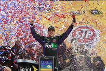 Denny Hamlin celebrates in Victory Lane after winning the NASCAR Sprint Cup Series auto race at Kansas Speedway in Kansas City, Kan., Sunday, April 22, 2012. (AP Photo/LAT, Michael L. Levitt) MANDATORY CREDIT