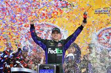 Denny Hamlin celebrates after winning the NASCAR Sprint Cup Series auto race at Kansas Speedway in Kansas City, Kan., Sunday, April 22, 2012. (AP Photo/Autostock, Brian Czobat) MANDATORY CREDIT