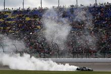Denny Hamlin performs a burnout after winning the NASCAR Sprint Cup Series auto race at Kansas Speedway in Kansas City, Kan., Sunday, April 22, 2012. (AP Photo/LAT, Michael L. Levitt) MANDATORY CREDIT