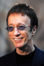 FILE  This Wednesday April 11, 2007 file photo shows Bee Gees singer Robin Gibb as he talks with journalists at the European Parliament in Brussels. Robin Gibb's spokesman said on Saturday April 21, 2012 the Bee Gees star has woken from a coma and is showing signs of recovery. (AP Photo/Geert Vanden Wijngaert)