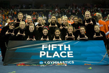 Podium picture of the University of Utah Gymnastics Team at the NCAA Gymnastics Finals. Credit Nathan Sweet, University of Utah