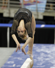 Utah's Cortni Beers competes on the balance beam during the finals of the NCAA women's gymnastics championships  Saturday, April 21 2012 in Duluth, Ga., . (AP Photo/John Bazemore)