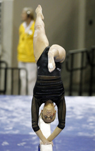 Utah's Mary Beth Lofgren competes on the balance beam during the finals of the NCAA women's gymnastics championships on  Saturday, April 21 2012, in Duluth, Ga. (AP Photo/John Bazemore)