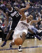 Charlotte Bobcats' Gerald Henderson (15) reacts as he is fouled by Sacramento Kings' Tyreke Evans (13) during the first half of an NBA basketball game in Charlotte, N.C., Sunday, April 22, 2012. (AP Photo/Chuck Burton)