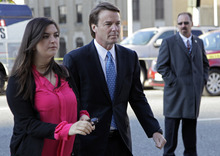 Chuck Burton     The Associated Press Former presidential candidate and U.S. Sen. John Edwards arrives Monday outside federal court with his daughter Cate in Greensboro, N.C.
