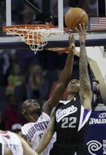 Sacramento Kings' Isaiah Thomas (22) shoots over Charlotte Bobcats' Bismack Biyombo (0) during the first half of an NBA basketball game in Charlotte, N.C., Sunday, April 22, 2012. (AP Photo/Chuck Burton)