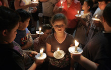 Little children with their parents light and hold candles at a vigil in the parking lot near a police command post in Tucson, Ariz., on Sunday, April 23, 2012, in honor of the missing 6-year-old Isabel Celis.   The girl's disappearance has prompted a massive search with more than 150 law enforcement officers trying to figure out whether she was abducted, a police spokeswoman said Sunday.  (AP Photo/ Benjie Sanders/Arizona Daily Star ) NO MAGS/NO SALES/MANDATORY CREDIT