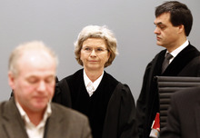 Judges Wenche E. Arntzen, center, and Arne Lyng, right, enter the courtroom to continue the case against defendant Anders Behring Breivik on day 6 of the trial in Oslo, Monday April 23, 2012. Breivik has admitted setting off a car bomb outside the government headquarters, killing eight, before unleashing a shooting massacre at the governing Labor Party's youth camp on Utoya. (AP Photo/Lise Aserud, POOL)