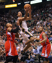 Steve Griffin  |  The Salt Lake Tribune   Utah's Devin Harris splits the defense Randy Foye and Caron Butler, of the Clippers, during first half action of the Utah Jazz versus Los Angeles Clippers game at EnergySolutions Arean in Salt Lake City, Utah  Tuesday, January 17, 2012.