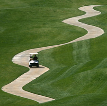 Steve Griffin/The Salt Lake Tribune Back-to-back days of record-breaking tempatures lured players to the Old Mill Golf Course in Salt Lake City, Utah Monday April 23, 2012.