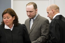 Terror- and murder charged Anders Behring Breivik arrives in the courtroom in Oslo Tuesday April 24, 2012. He is flanked by his defence lawyers Geir Lippestad, right, and Vibeke Hein Baera. Confessed mass killer Anders Behring Breivik vehemently defended his sanity after a forensic panel found flaws in a psychiatric report that declared him sane in the eyes of the law. As the trial for Breivik's bomb-and-shooting rampage that killed 77 people entered its second week, Monday, the far-right fanatic told a court that he was the victim of a
