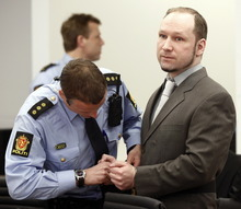 Terror- and murder charged Anders Behring Breivik has his handcuffs released as he arrives in the courtroom in Oslo Tuesday April 24, 2012. Confessed mass killer Anders Behring Breivik vehemently defended his sanity after a forensic panel found flaws in a psychiatric report that declared him sane in the eyes of the law. As the trial for Breivik's bomb-and-shooting rampage that killed 77 people entered its second week, Monday, the far-right fanatic told a court that he was the victim of a