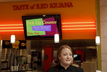 Trent Nelson     The Salt Lake Tribune Taste of Red Iguana Manager Kate Lubing shares her perspectives Tuesday on consumer attitudes, comparing business since the location's opening last year at City Creek Center in downtown Salt Lake City.