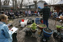 Scott Sommerdorf  |  The Salt Lake Tribune              Urban homesteader Jonathan Krausert teaches a class on how to grow vegetables and flowers in colorful containers, at Wasatch Community Garden, Saturday, March 24, 2012. The session was structured mostly as a question-answer format.