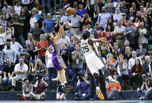 Chris Detrick  |  The Salt Lake Tribune Phoenix Suns point guard Steve Nash (13) shoots over Utah Jazz center Al Jefferson (25) during the second half of the game at EnergySolutions Arena Wednesday April 4, 2012. Phoenix won the game 107-105.