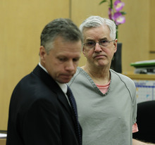 Steve Powell, right, appears in a Pierce County Superior Court hearing with his attorney, Mark Quigley, left, Monday, April 23, 2012, in Tacoma, Wash. Quigley said Monday that investigators frustrated by their unsuccessful quest to find Powell's missing daughter-in-law pursued an