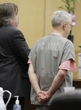 Steve Powell, right, and Travis Currie, left, one of his attorneys, appear in a Pierce County Superior Court hearing, Monday, April 23, 2012, in Tacoma, Wash. Powell's attorney said Monday that investigators frustrated by their unsuccessful quest to find Powell's missing daughter-in-law pursued an