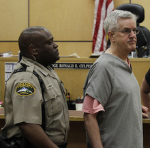 Steve Powell is led from a Pierce County Superior Court hearing, Monday, April 23, 2012, in Tacoma, Wash. Powell's attorney said Monday that investigators frustrated by their unsuccessful quest to find Powell's missing daughter-in-law pursued an