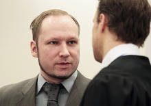 Anders Behring Breivik in conversation with member of his defence team Tord Jordet in the courtroom in Oslo Wednesday, April 25, 2012. After testifying for five days, Anders Behring Breivik listened silently Tuesday as others described the mayhem caused by his bombing of Oslo's government district, a scene one witness described as a