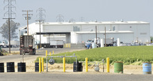 This Tuesday, April 24, 2012, photo shows an exterior view of Baker Commodities transfer station, where a cow with mad cow disease was discovered, in Hanford, Calif. The first new case of mad cow disease in the U.S. since 2006 has been discovered in a dairy cow in California, but health authorities said Tuesday the animal never was a threat to the nation's food supply. The infected cow, the fourth ever discovered in the U.S., was found as part of an Agriculture Department surveillance program that tests about 40,000 cows a year for the fatal brain disease. (AP Photo/The Fresno Bee, John Walker )