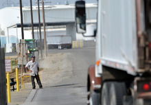 In this Tuesday, April 24, 2012, photo, a truck leaves the plant at Baker Commodities transfer station, where a cow with mad cow disease was discovered, in Hanford, Calif. The first new case of mad cow disease in the U.S. since 2006 has been discovered in a dairy cow in California, but health authorities said Tuesday the animal never was a threat to the nation's food supply. The infected cow, the fourth ever discovered in the U.S., was found as part of an Agriculture Department surveillance program that tests about 40,000 cows a year for the fatal brain disease. (AP Photo/The Fresno Bee, John Walker )