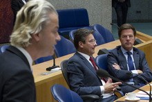 Caretaker Prime Minister Mark Rutte, right, and deputy prime minister Maxime Verhagen, center, listen to anti-EU lawmaker Geert Wilders, left, as he addresses parliament in The Hague, Netherlands, Tuesday April 24, 2012. Rutte appealed to a polarized Dutch Parliament on Tuesday to help him get the economy back on track rather than let the country drift in political limbo until new elections. Speaking publicly for the first time since he tendered his resignation Monday, Rutte said the nation, long considered one of Europe's most fiscally responsible, has no time to waste in tackling its economic woes. (AP Photo/Peter Dejong)