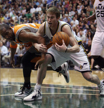 Steve Griffin/The Salt Lake Tribune   Utah's Gordon Hayward and Michael Redd battle for the ball during a game against Phoenix  at EnergySolutions Arena in Salt Lake City, on Tuesday, April 24, 2012.