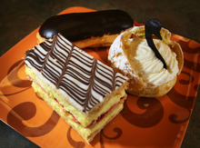 Steve Griffin | The Salt Lake Tribune Specialties at Sweetly Divine include Napoleons, swan-shaped cream puffs and éclairs.