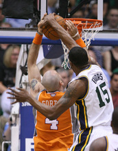 Steve Griffin/The Salt Lake Tribune   Utah's Derrick Favors blocks the shot of Phoenix center Marcin Gortat during a game at EnergySolutions Arena in Salt Lake City, on Tuesday, April 24, 2012.